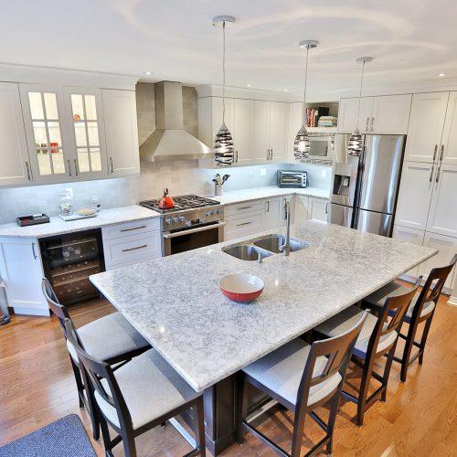White kitchen with island sink